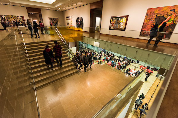 Guests walk up the stairs to explore an upper floor of the Chazen.