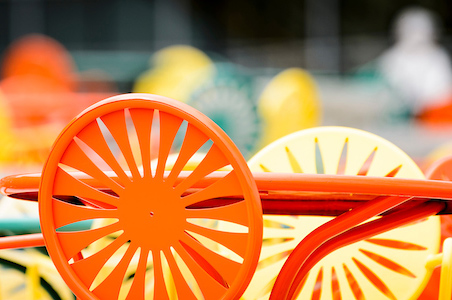 An orange and yellow chair with sunburst pattern.